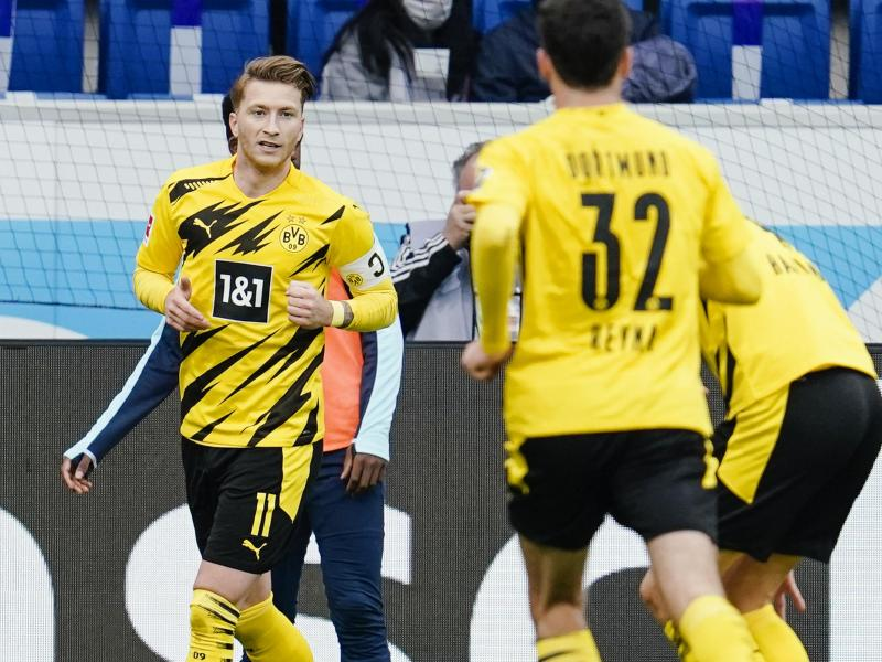 BVB-Kapitän Marco Reus (l) war Dortmunds Matchwinner in Sinsheim. Foto: Uwe Anspach/dpa (© Uwe Anspach)